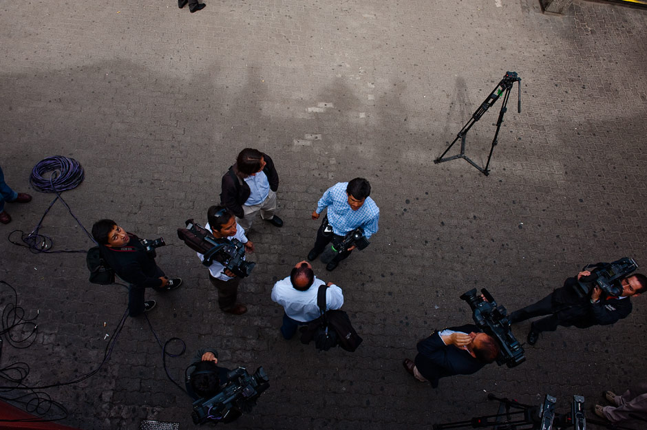 Local news media gather to cover the story of the Banquedano station shutdown
